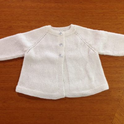 Classic cream hand knitted cardigan in sizes 0-6mths & 6-12 months