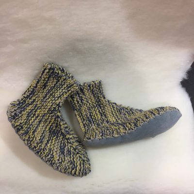 Handknitted sock with sheepskin soft sole.